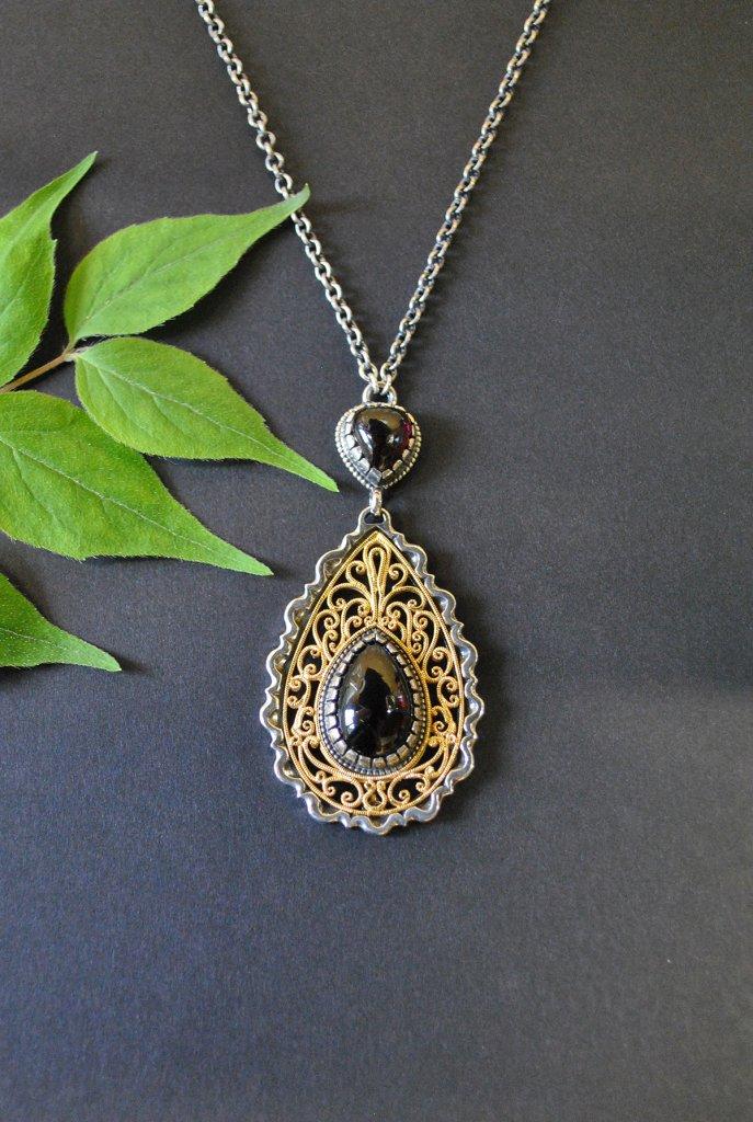 Trachtenkette Silber mit vergoldeten Details und Granat