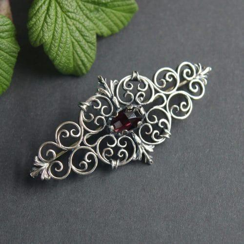 Dirndlnadel in Silber mit Granat