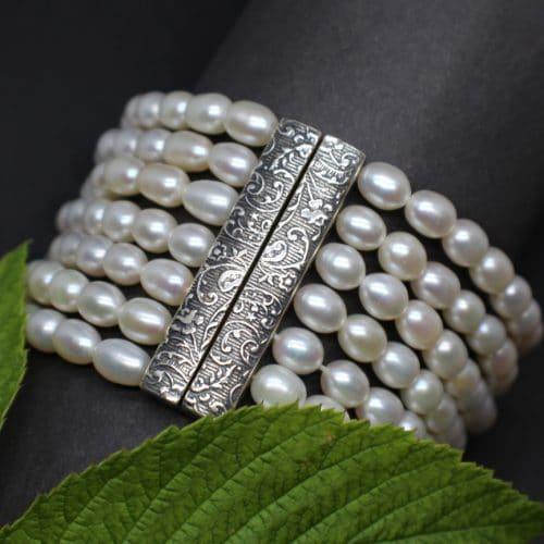 7 reihiges Trachtenschmuck Armband mit silberner Schließe und Perlen gefädelt